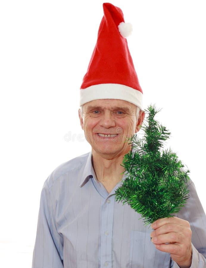 O homem no chapéu de Papai Noel fotos de stock