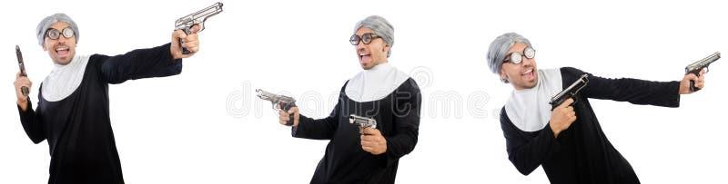 O homem no vestido da freira com revólver imagens de stock royalty free