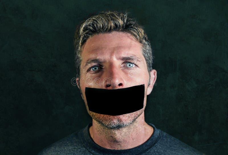 O homem novo com boca e os bordos selaram coberto com a fita adesiva imagens de stock royalty free