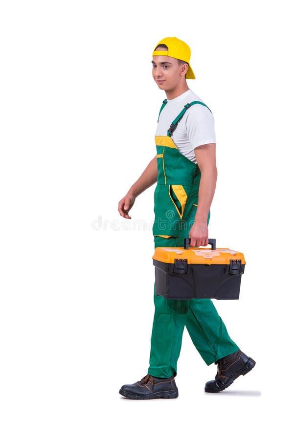 O homem novo com a caixa de ferramentas do conjunto de ferramentas isolada no branco imagens de stock