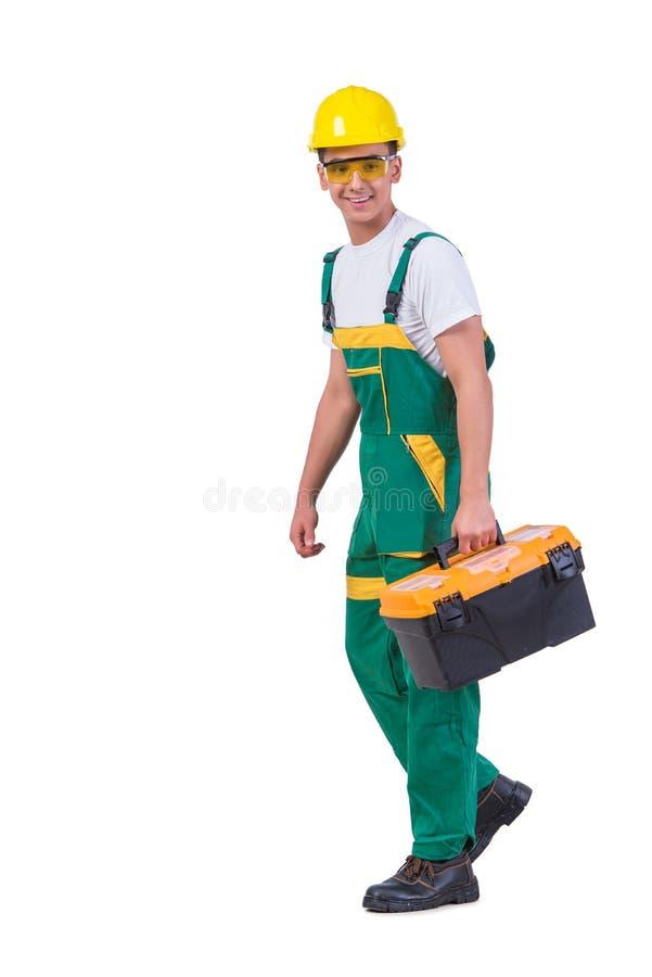 O homem novo com a caixa de ferramentas do conjunto de ferramentas isolada no branco fotografia de stock royalty free