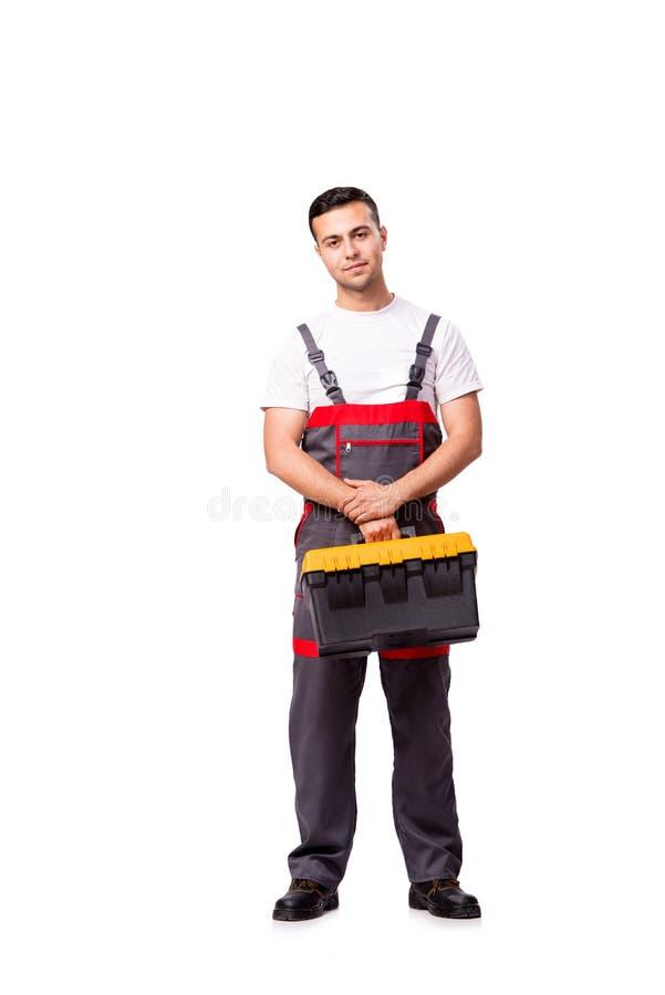 O homem novo com a caixa de ferramentas do conjunto de ferramentas isolada no branco foto de stock