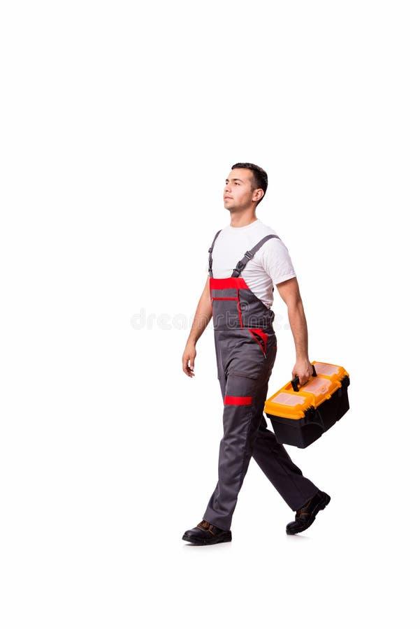 O homem novo com a caixa de ferramentas do conjunto de ferramentas isolada no branco imagem de stock