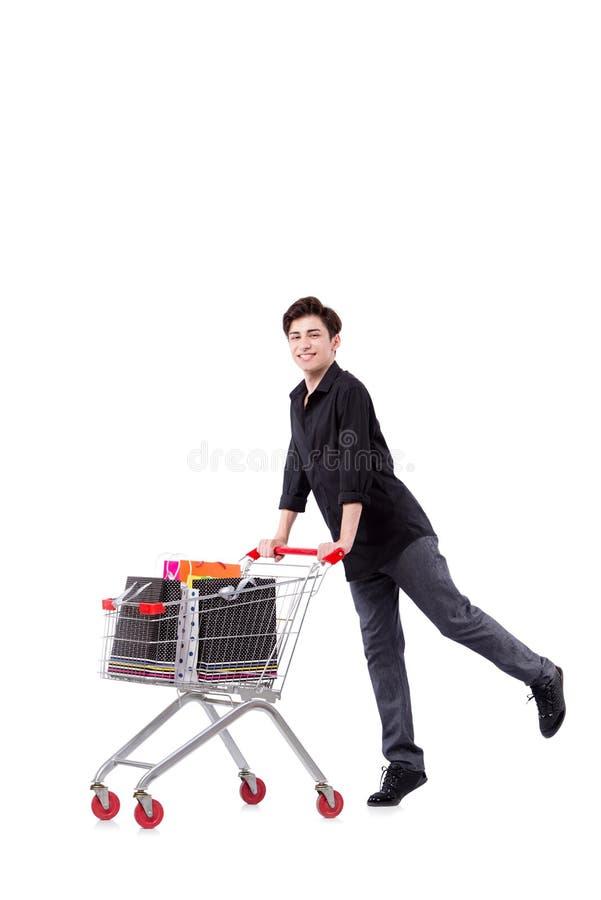 O homem novo com carrinho de compras e sacos isolados no branco fotos de stock