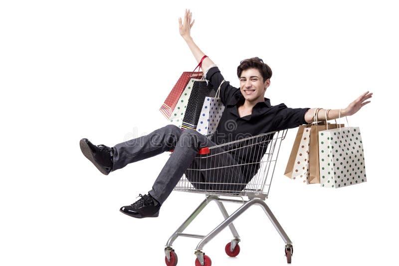 O homem novo com carrinho de compras e sacos isolados no branco imagem de stock royalty free