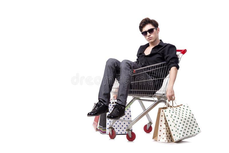 O homem novo com carrinho de compras e sacos isolados no branco fotos de stock royalty free