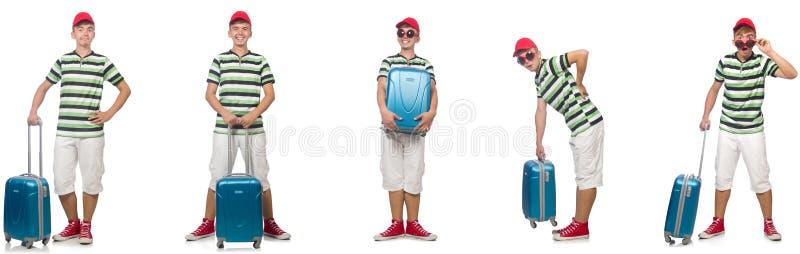 O homem novo com a mala de viagem isolada no branco fotos de stock