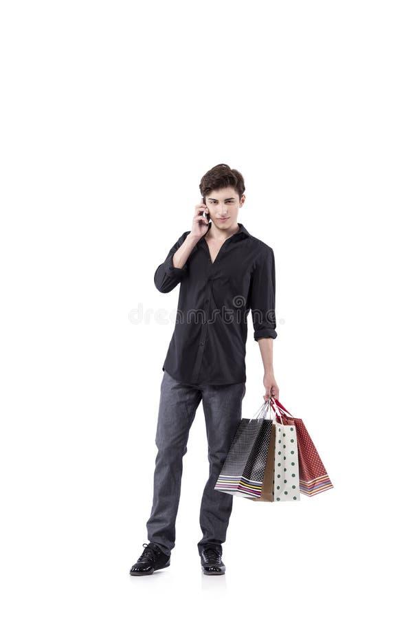 O homem novo no conceito da compra isolado no branco imagem de stock