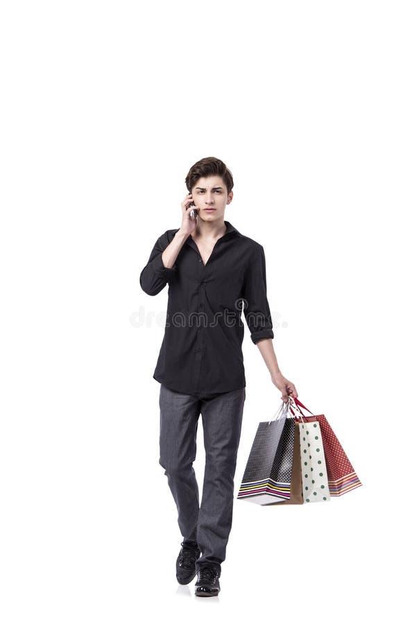 O homem novo no conceito da compra isolado no branco foto de stock