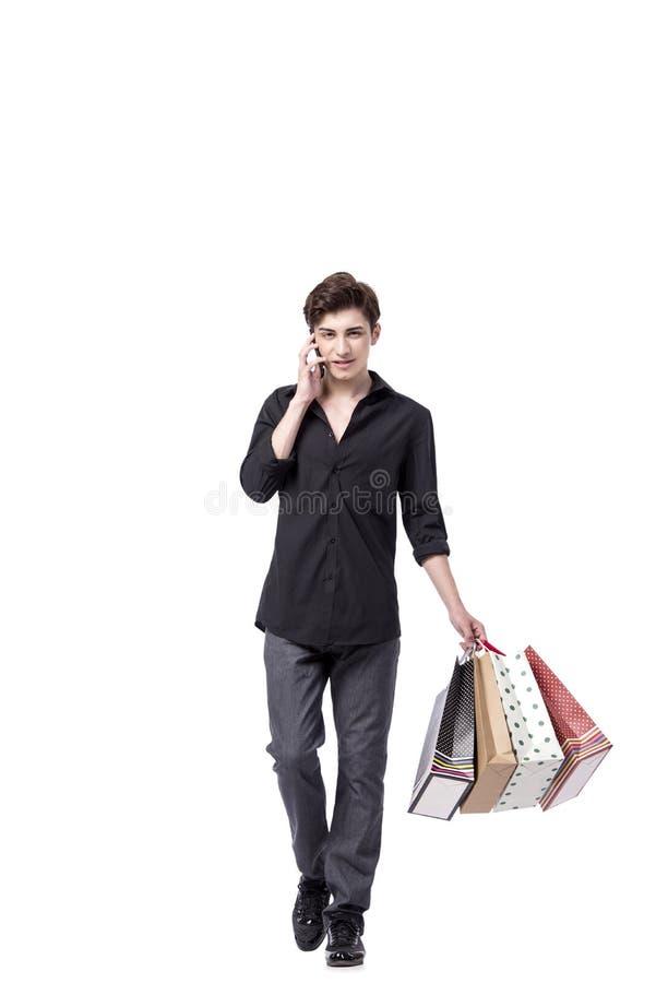 O homem novo no conceito da compra isolado no branco fotos de stock royalty free