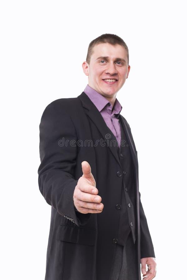 O homem novo prende para fora sua mão foto de stock