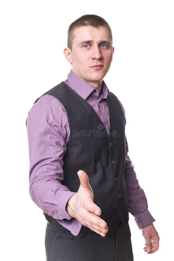 O homem novo prende para fora sua mão imagens de stock