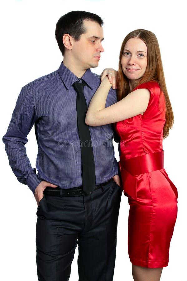 O homem olha uma mulher imagens de stock