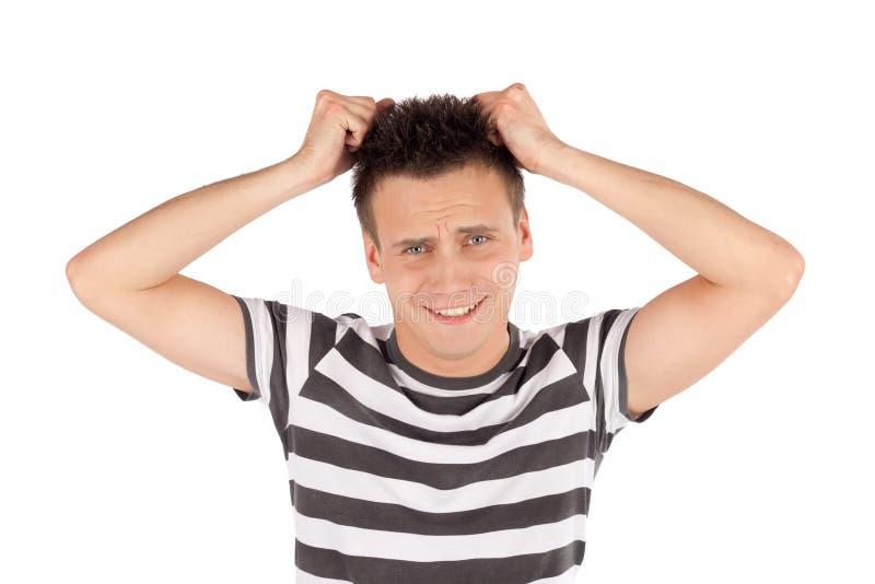 O homem retira o cabelo fotos de stock royalty free