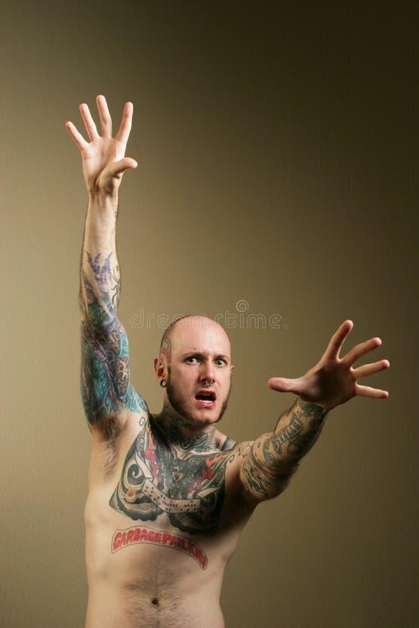 O homem Scared ou choc com seus braços abre imagens de stock royalty free