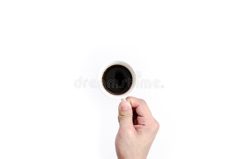 O homem tem guardar para beber o café preto na manhã preto fotos de stock royalty free