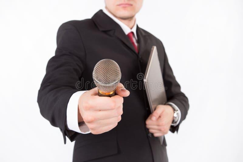 O homem toma alguma entrevista foto de stock