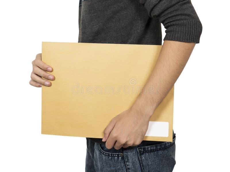 O homem traz o envelope marrom fotografia de stock