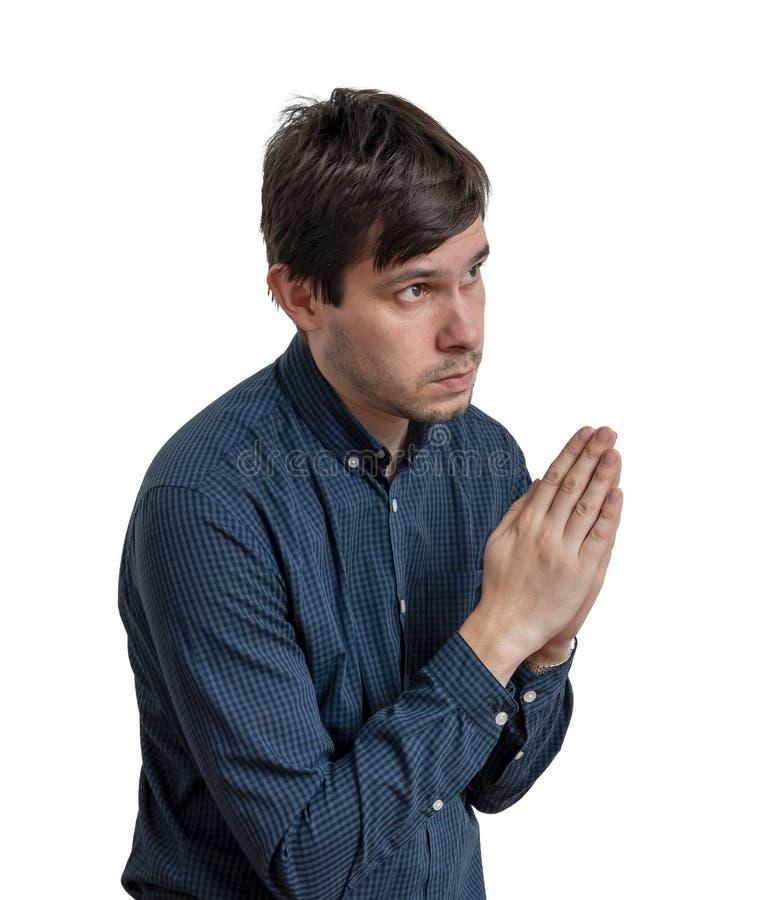 O homem triste é de pedido e pedindo a ajuda Isolado no fundo branco fotos de stock royalty free