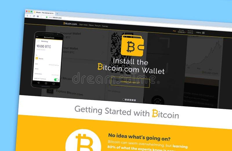 O homepage do Web site de Bitcoin em uma tela de monitor fotografia de stock