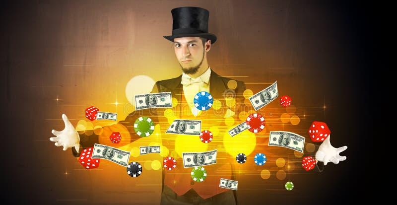 O ilusionista conjura com seu pessoal de jogo da mão foto de stock