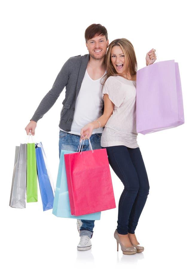 O indivíduo e o galão trazem sacos de compras fotos de stock royalty free