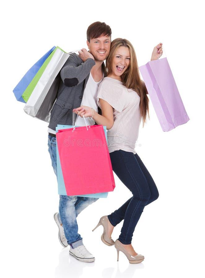 O indivíduo e o galão trazem sacos de compras imagens de stock