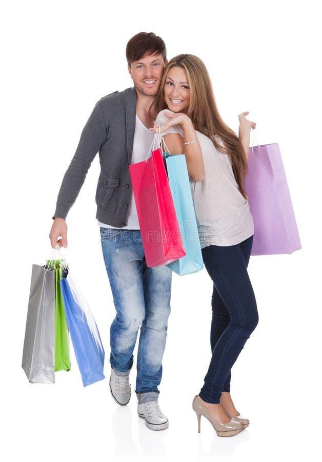 O indivíduo e o galão trazem sacos de compras foto de stock