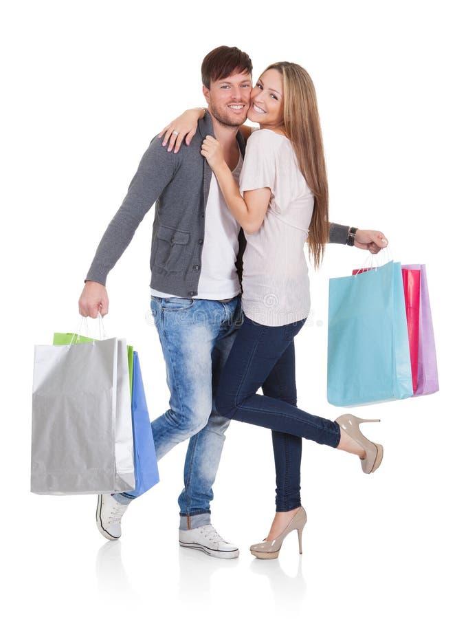 O indivíduo e o galão trazem sacos de compras imagens de stock royalty free