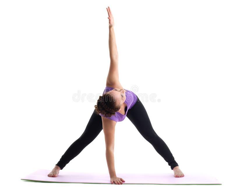 O instrutor da ioga da mulher nova demonstra o asana foto de stock royalty free
