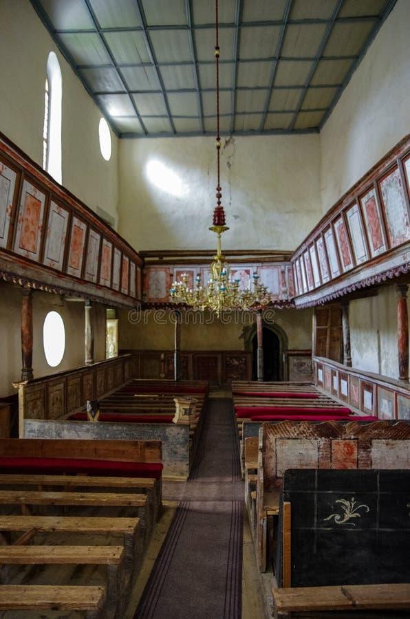 O interior do Viscri fortificou a igreja Por volta de 1100 o ANÚNCIO originalmente construído, a igreja é agora um monumento do U imagens de stock royalty free