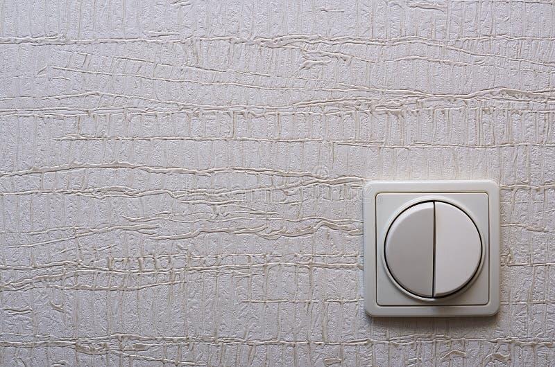 O interruptor da parede no direito inferior fotos de stock