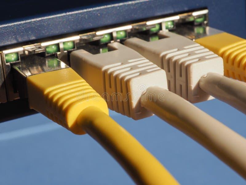 O interruptor do roteador do modem com ethernet RJ45 obstrui portos imagens de stock royalty free