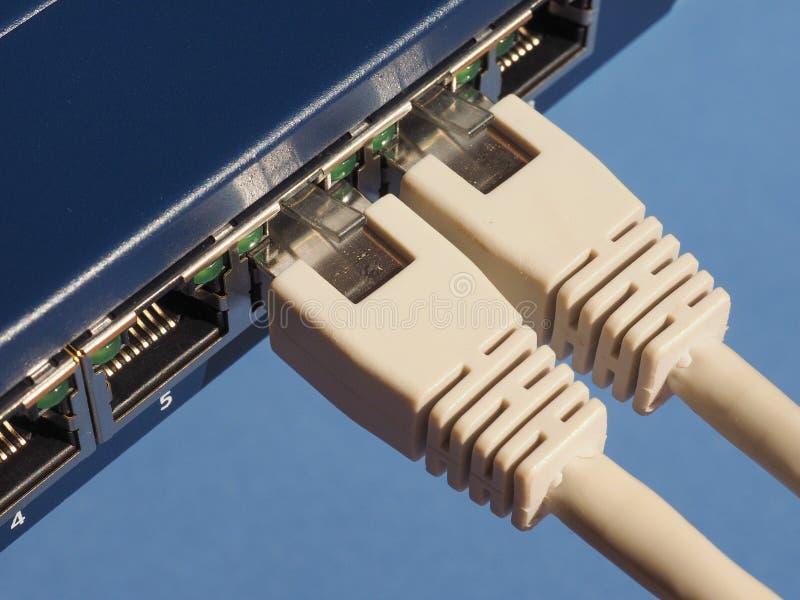 O interruptor do roteador do modem com ethernet RJ45 obstrui portos fotos de stock royalty free