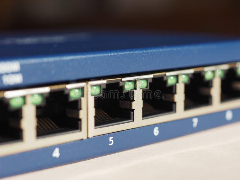 O interruptor do roteador do modem com ethernet RJ45 obstrui portos fotografia de stock