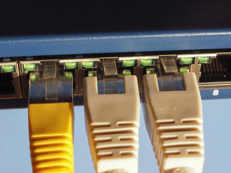 O interruptor do roteador do modem com ethernet RJ45 obstrui portos fotografia de stock royalty free