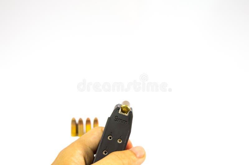 O isolado do compartimento e da bala da arma foto de stock