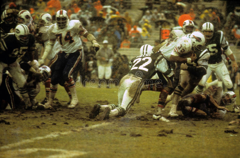 O. J. Simpson v. the New York Jets. Buffalo Bills runningback OJ Simpson runs the ball through the New York Jets defense. (image taken from color slide royalty free stock photography