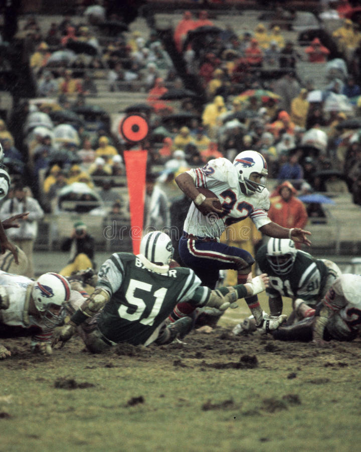O.J. Simpson v. the New York Jets. Buffalo Bills runningback OJ Simpson runs the ball through the New York Jets defense. (image taken from color slide royalty free stock photography