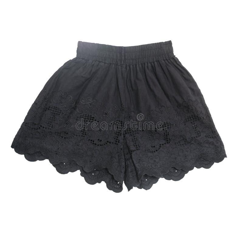 O laço bonito preto bonito das calças curtos das mulheres faz crochê no branco fotografia de stock