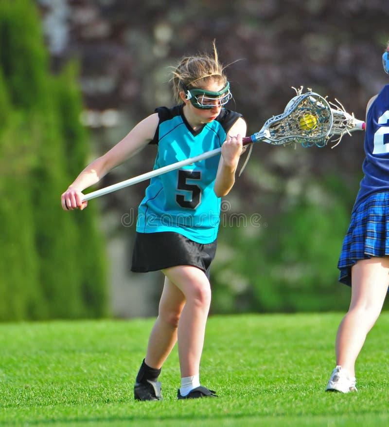 O Lacrosse das mulheres enfrenta fora fotos de stock royalty free