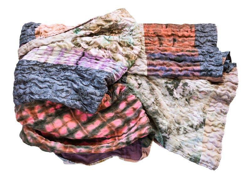 O lenço de seda feito a mão dobrado dos retalhos isolou-se imagens de stock