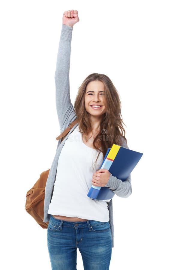 O levantamento entusiasmado do estudante fêmea entrega sua mão isolada no branco imagem de stock royalty free