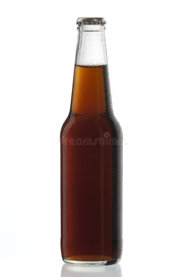 O libre de Cuba da bebida alcoólica de garrafa de soda com água deixa cair fotografia de stock royalty free