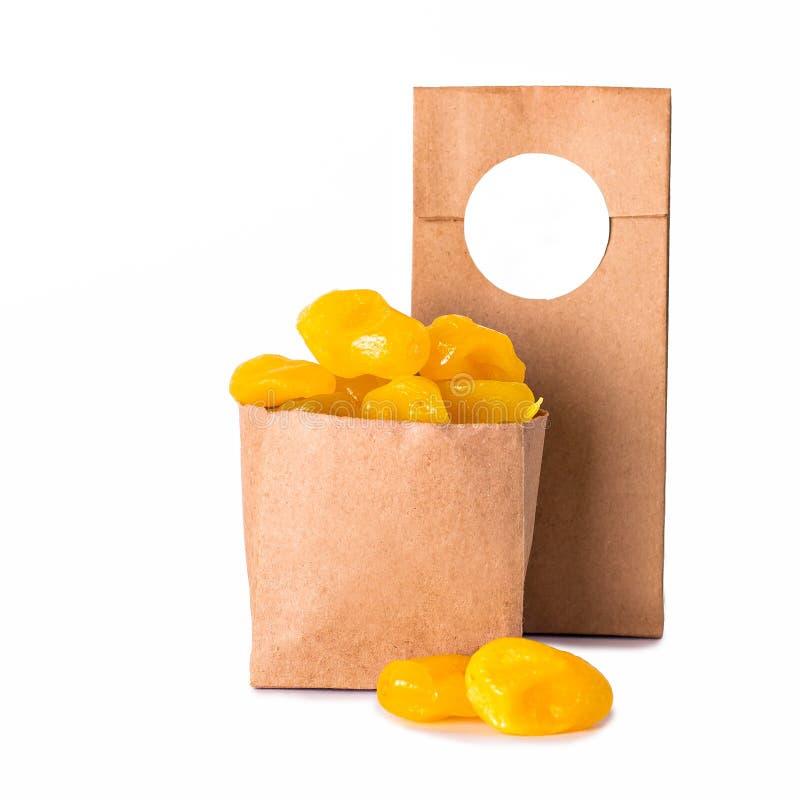 O limão secou no açúcar (kumquat) no pacote do ofício imagens de stock royalty free