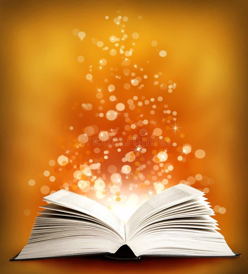 O livro mágico aberto com sparklings fotografia de stock royalty free