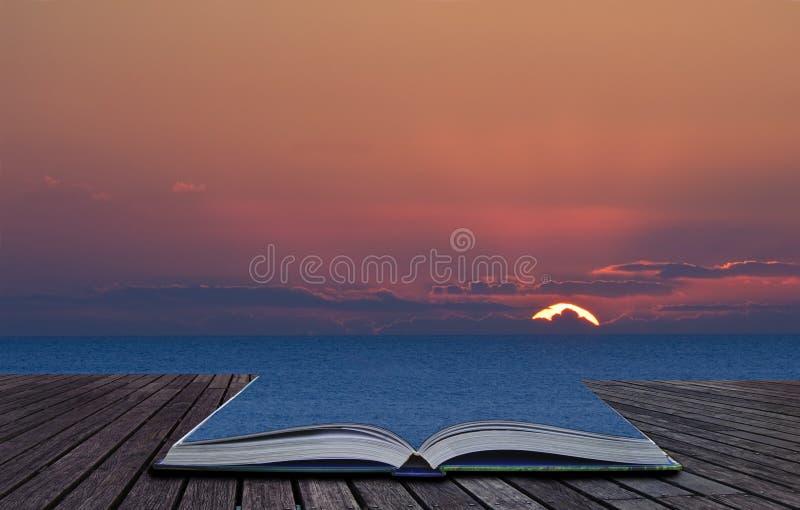 O livro mágico satisfaz o derramamento na paisagem foto de stock royalty free