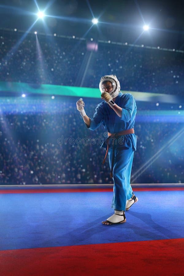 O lutador de Kudo está dando certo na arena grande fotografia de stock