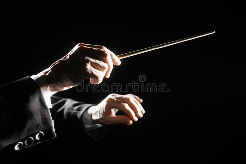 O maestro de orquestra entrega o bastão fotos de stock