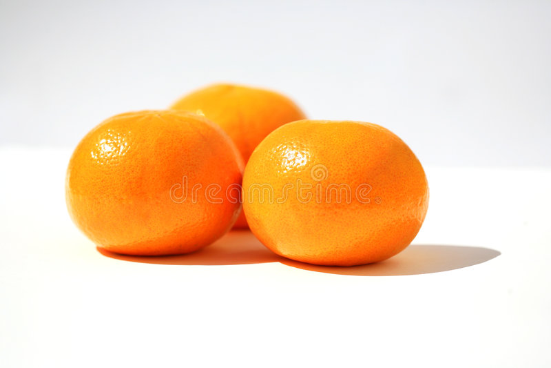 O mandarino três imagens de stock royalty free